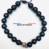 Bracelet pierre Onyx Mat 8 mm et un Crane argenté vue du dessus